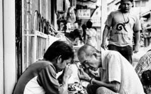 Two Men Being Bent On Phra Kruang
