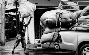 Man Flinging Big Bag