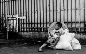 Boy Sitting On Bags
