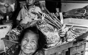 Older Woman Relaxing In Greengrocery