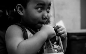 Boy Drinking A Cold Beverage