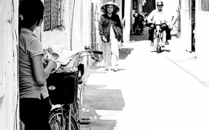 Young Woman And A Bicycle In The Shade