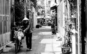 Peddler Walking Her Bicycle
