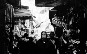Black Hijab In The Crowded Lane