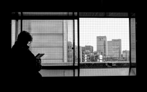 Buildings And A Silhouette Of A Man