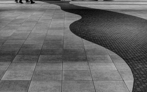 Pedestrians And A Big Woman