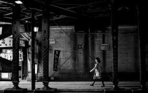 Woman Walking The Railway Underpass