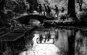 People On The Small Stone Bridge