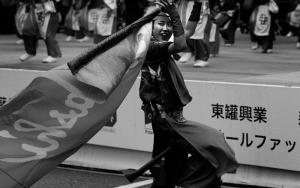 Woman Waving A Flag