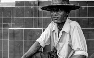 Man Wearing A Rattan Hat