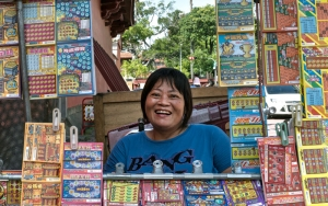 Woman Selling Lottery